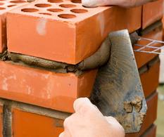 Construire un muret en briquettes